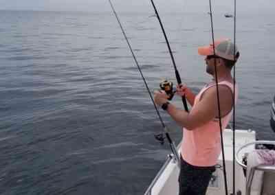a fisherman fighting a fish