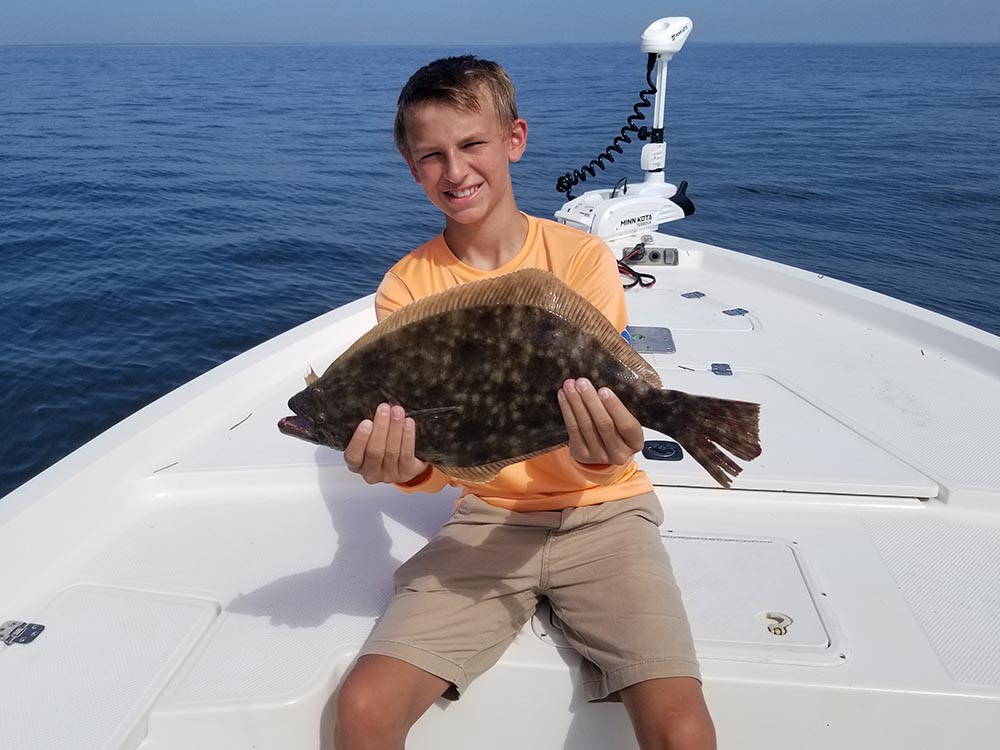 a fisherman with a flounder