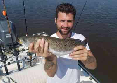 a fisherman with a seatrout