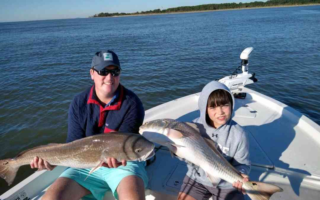 anglers with redfish