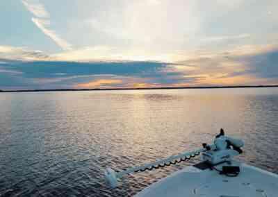 boat overlooking sunrise.