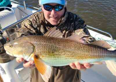 fisherman with a redfish